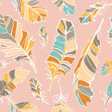 Seamless pattern of colored feathers Stock Images