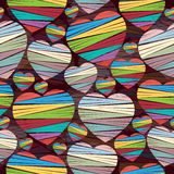 Seamless pattern of colored hearts with stripes on a dark background. Valentine's Day. Vector illustration Royalty Free Stock Images