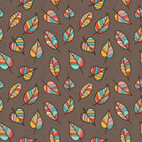 Seamless Pattern of Colored Leaves on Brown Background. Royalty Free Stock Photo