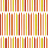 Seamless pattern with colored pencils, crayons on white background Royalty Free Stock Images