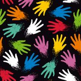 Seamless pattern of colored randomly hands Stock Photos