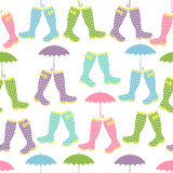 Seamless pattern with colored rubber boots and umbrellas. Vector Stock Image