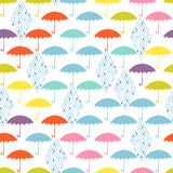 Seamless pattern with colored umbrellas and rain on a white back Stock Image