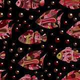 Seamless pattern with colored zentangle doodle fishes. Vintage. Stock Images