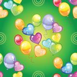 Seamless pattern with colorful balloons on green background Royalty Free Stock Photo