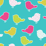 Seamless pattern with colorful birds. Silhouettes on yellow background. Birds in polka dots Royalty Free Stock Photography
