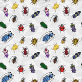 Seamless pattern with colorful bugs. Bright  drawing of small beetles. Insect on the background with gray leaves. Cartoon bug wallpaper Royalty Free Stock Photography
