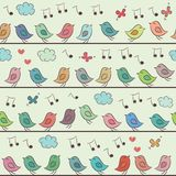 Seamless pattern of colorful cartoon birds. Royalty Free Stock Photography