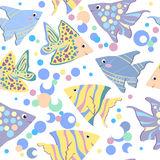 Seamless pattern with colorful cartoon fishes Royalty Free Stock Image