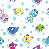 Seamless pattern with colorful cartoon fishes. white background Royalty Free Stock Image