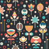 Seamless pattern with colorful Christmas flowers on dark background. Stock Image
