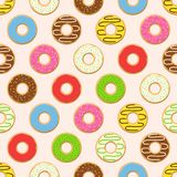 Seamless pattern colorful donuts with glaze, sprinkles on pink background. Royalty Free Stock Photos