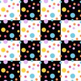 Seamless pattern with colorful dots on black and white squares. Royalty Free Stock Photo