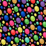Seamless pattern of colorful drops. On black background Royalty Free Stock Images