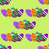 Seamless pattern with colorful Easter eggs. On the green background Stock Photography
