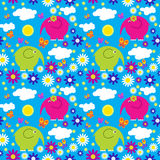 Seamless pattern with colorful elephants on a background of clou Royalty Free Stock Photography