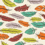 Seamless pattern of colorful feathers. Seamless pattern of colorful bird feathers in a random arrangement and square format suitable for wallpaper  textile or Stock Images