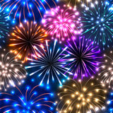 Seamless pattern with colorful fireworks. On dark background Royalty Free Stock Images