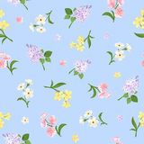 Seamless pattern with colorful flowers on blue. Vector illustration. Royalty Free Stock Photos