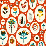 Seamless pattern with colorful flowers on red background. Stock Image