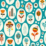 Seamless pattern with colorful flowers on turquoise background. Stock Photos