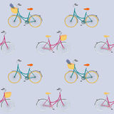 Seamless pattern with colorful hand drawn city bikes. Stock Photos