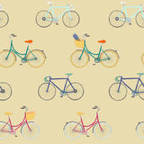 Seamless pattern with colorful hand drawn city bikes and racing bikes. Stock Image