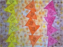 Seamless pattern with colorful hands in triangles. Drawn by hand. royalty free illustration
