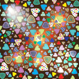 Seamless pattern of colorful hearts on a dark background. With illumination Stock Images