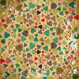 Seamless pattern of colorful hearts on old shabby paper.  Royalty Free Stock Images
