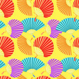 Seamless pattern colorful Japanese fan of on a yellow background Stock Photography