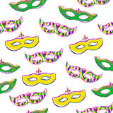 Seamless pattern with colorful masks on white. Vector seamless pattern with colorful Mardi Gras face masks on white background for your design. Cute background Stock Photo