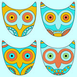 Seamless pattern, colorful owls on a blue backgrou Royalty Free Stock Photography