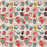 Seamless pattern with colorful owls on cream background.  Stock Image