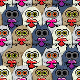 Seamless pattern colorful owls with hearts. Royalty Free Stock Image