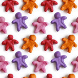 Seamless pattern of colorful plasticine peoples isolated on white background. Rainbow modeling clay texture Stock Image