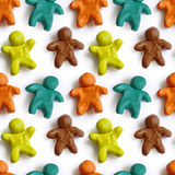 Seamless pattern of colorful plasticine peoples isolated on white background. Rainbow modeling clay texture Stock Photos