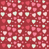 Seamless pattern with colorful random size hearts. Stock Images