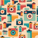 Seamless pattern with colorful retro cameras and films. Royalty Free Stock Photos