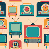 Seamless pattern with colorful retro TVs and radio receivers. Royalty Free Stock Photos