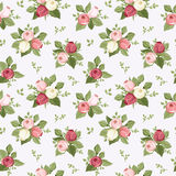 Seamless pattern with colorful rose buds on blue. Royalty Free Stock Photography