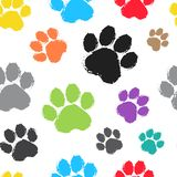 Seamless pattern with colorful silhouette animal paw track. Vector illustration stock illustration