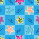 Seamless pattern with colorful star-fishes. On blue background Royalty Free Stock Photography