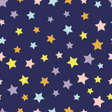 Seamless pattern with colorful stars on dark background. Vector illustration. Royalty Free Stock Photography