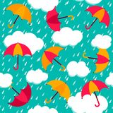 Seamless pattern with colorful umbrellas. Autumn pattern with colorful umbrellas and rain. Seamless vector background stock illustration