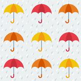 Seamless pattern with colorful umbrellas. Autumn pattern with colorful umbrellas and rain. Seamless vector background Stock Photos