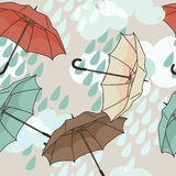 Seamless pattern with colorful umbrellas and clouds. Vector illustration Royalty Free Stock Image