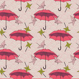 Seamless pattern with colorful umbrellas and origami cranes in asian style. Vector illustration Stock Image