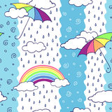 Seamless pattern with colorful umbrellas and rainbow. Royalty Free Stock Photography