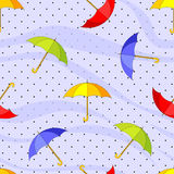 Seamless pattern with colorful umbrellas and raindrops Royalty Free Stock Images